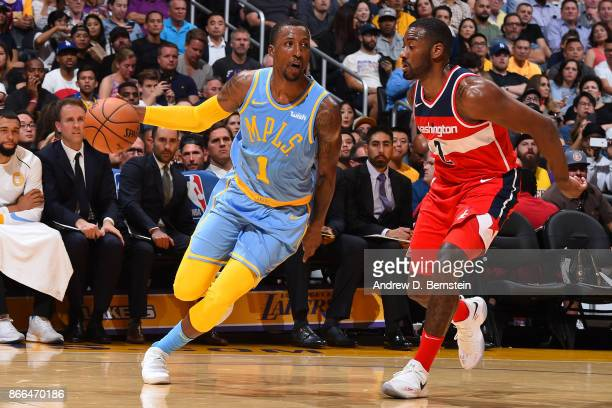 Kentavious CaldwellPope of the Los Angeles Lakers handles the ball against Chris McCullough of the Washington Wizards on October 25 2017 at STAPLES...