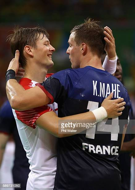 Kentin Mahe of France and Lasse Svan of Denmark hug each other after the Men's Preliminary Group A match between France and Denmark on Day 10 of the...