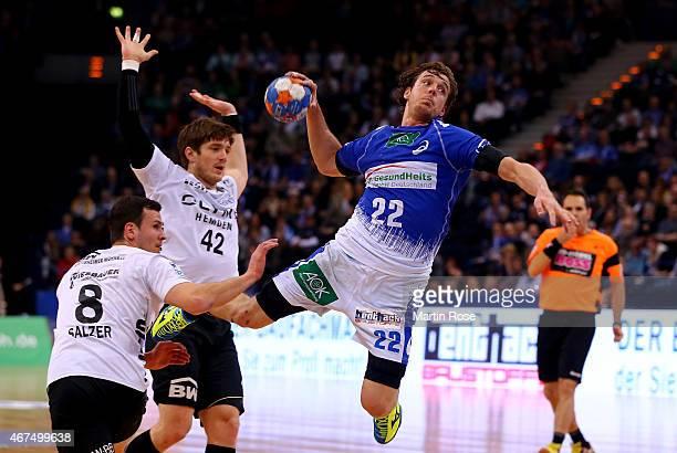 Kentin Mahe of Hamburg challenges Julius Emrich of Bietigheim during the DKB Bundesliga handball match between HSV Handball and SG BBM Bietigheim at...