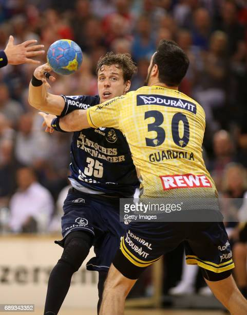 Kentin Mahe of SG Flensburg Handewitt fights for the ball with Gedeon Guardiola during to the Game SG Flensburg Handewitt v Rhein Neckar Loewen at...