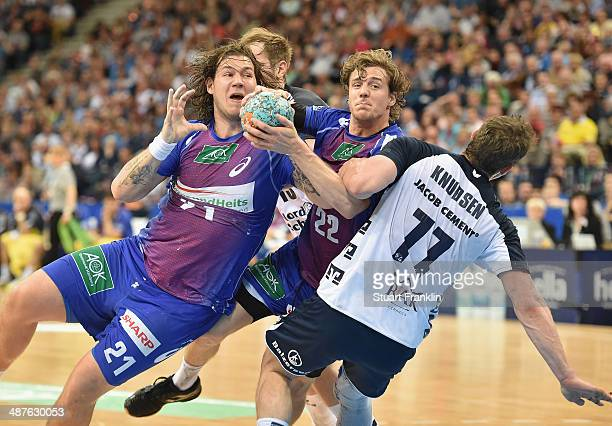 Kentin Mahee of Hamburg is challenged by Michael Knudsen of Flensburg during the DKB Bundesliga handball game between HSV Hamburg and SG Flensburg...