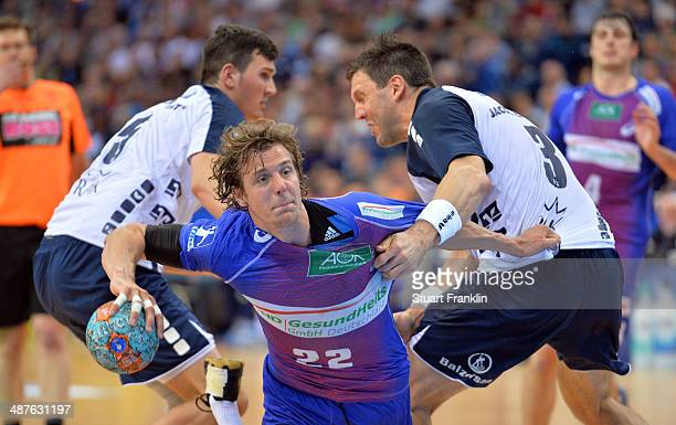 Kentin Mahee of Hamburg is challenged by Tobias Karlsson of Flensburg during the DKB Bundesliga handball game between HSV Hamburg and SG Flensburg...