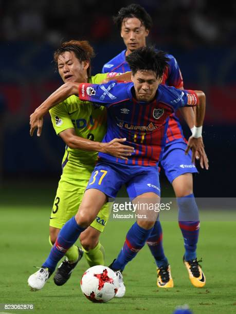 Kento Hashimoto of FC Tokyo and Soya Takahashi of Sanfrecce Hiroshima compete for the ball during the JLeague Levain Cup PlayOff Stage first leg...