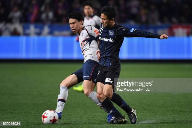 Kento Hashimoto of FC Tokyo and Yasuyuki Konno of Gamba Osaka compete for the ball during the JLeague J1 match between Gamba Osaka and FC Tokyo at...