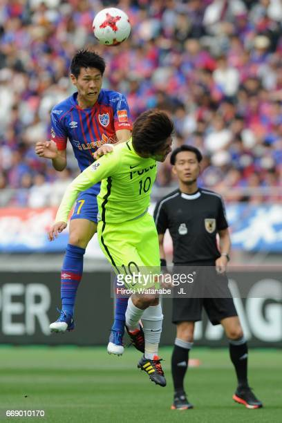 Kento Hashimoto of FC Tokyo and Yosuke Kashiwagi of Urawa Red Diamonds compete for the ball during the JLeague J1 match between FC Tokyo and Urawa...