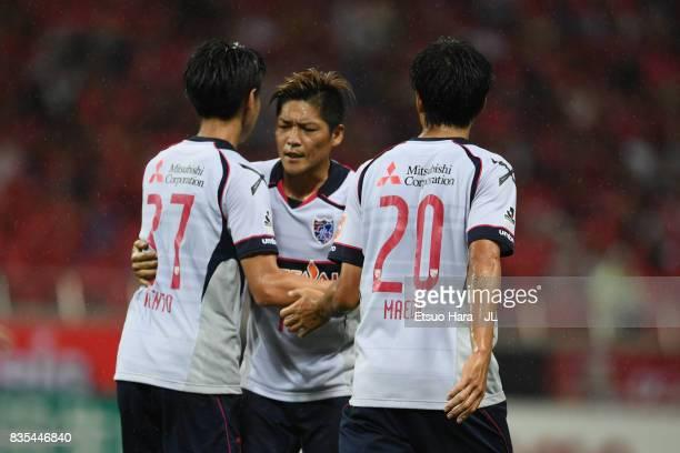 Kento Hashimoto of FC Tokyo celebrates scoring his side's second goal with his team mates Yoshito Okubo and Ryoichi Maeda during the JLeague J1 match...