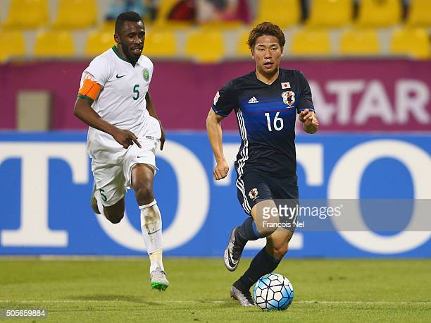 Kento Misao of Japan is chased by Talal Ali Absi of Saudi Arabia during the AFC U23 Championship Group B match between Saudi Arabia and Japan at...