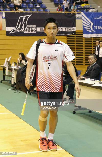 Kento Momota Japan's former world No 2 badminton star enters the venue of the Japan Ranking Circuit tournament in Saitama on May 27 after his...