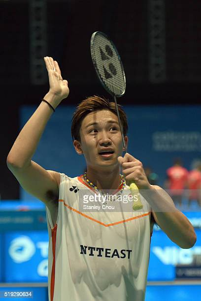 Kento Momota of Japan celebrates after he defeated HS Prannoy of India during round one of the BWF World Super Series Badminton Malaysia Open at...