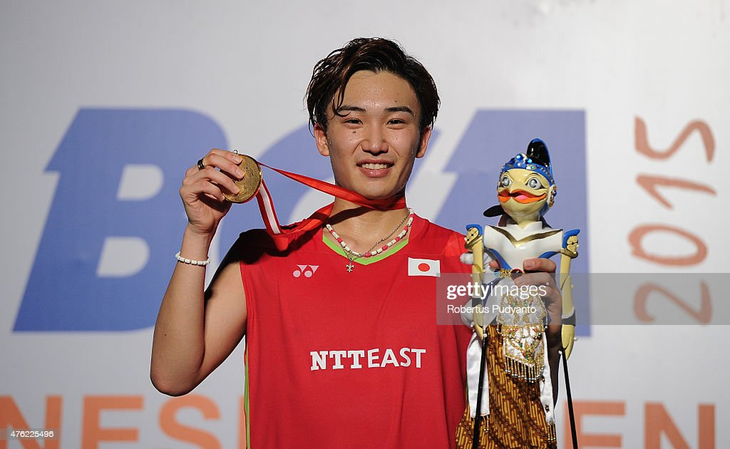 <a gi-track='captionPersonalityLinkClicked' href=/galleries/search?phrase=Kento+Momota&family=editorial&specificpeople=9148050 ng-click='$event.stopPropagation()'>Kento Momota</a> of Japan celebrates on the podium after winning Men's Singles in the 2015 BCA Indonesia Open at Istora Senayan on June 7, 2015 in Jakarta, Indonesia.