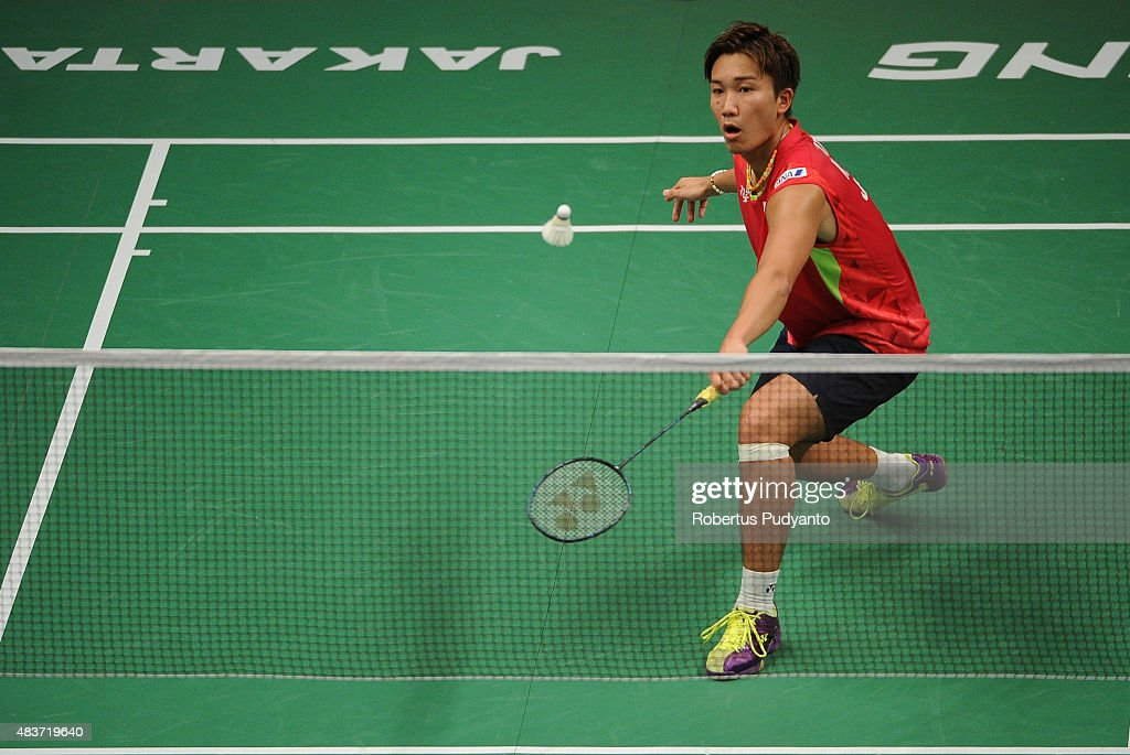 <a gi-track='captionPersonalityLinkClicked' href=/galleries/search?phrase=Kento+Momota&family=editorial&specificpeople=9148050 ng-click='$event.stopPropagation()'>Kento Momota</a> of Japan competes against Martin Giuffre of Canada in the 2015 Total BWF World Championship at Istora Senayan on August 12, 2015 in Jakarta, Indonesia.