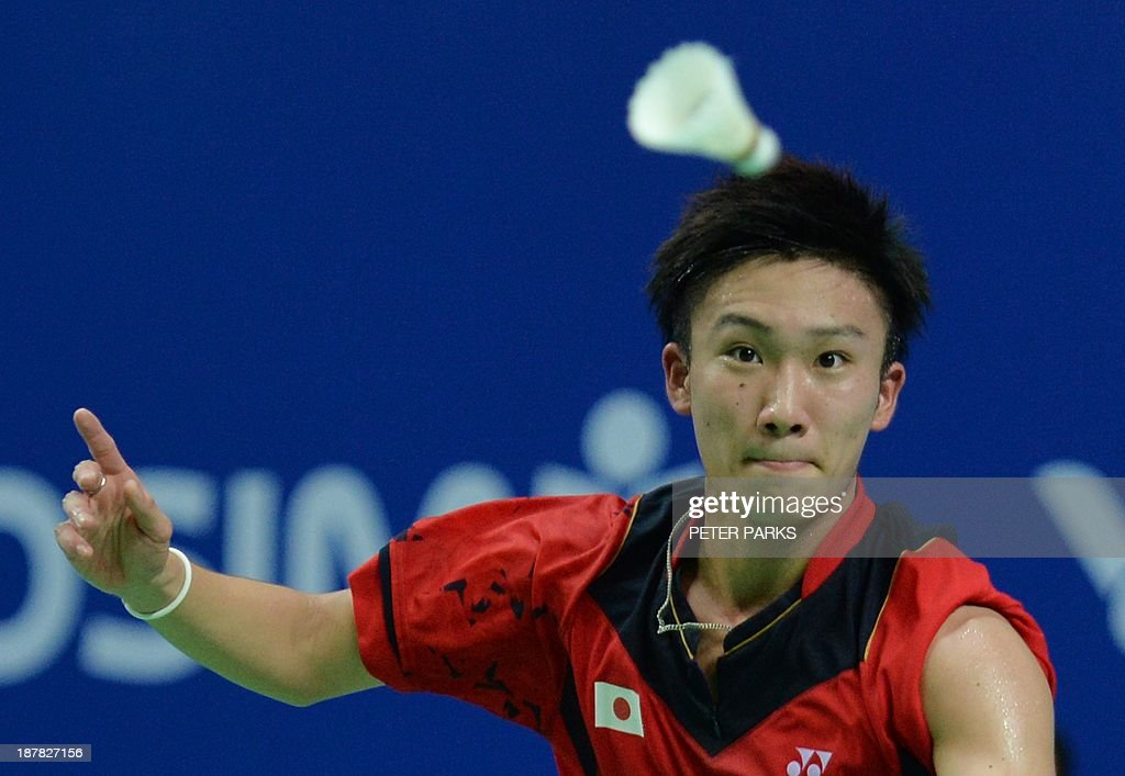 Kento Momota of Japan hits a return to Marc Zwiebler of Germany in the men's singles first round at the China Open badminton tournament in Shanghai on November 13, 2013. Momota won the match 21-18, 21-16. AFP PHOTO/Peter PARKS
