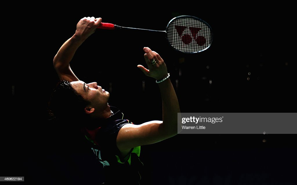 <a gi-track='captionPersonalityLinkClicked' href=/galleries/search?phrase=Kento+Momota&family=editorial&specificpeople=9148050 ng-click='$event.stopPropagation()'>Kento Momota</a> of Japan in action against Jan O Jorgensen of Denmark during the Men's Singles match on day two of the BWF Destination Dubai World Superseries Finals at the Hamdan Sports Complex on December 18, 2014 in Dubai, United Arab Emirates.