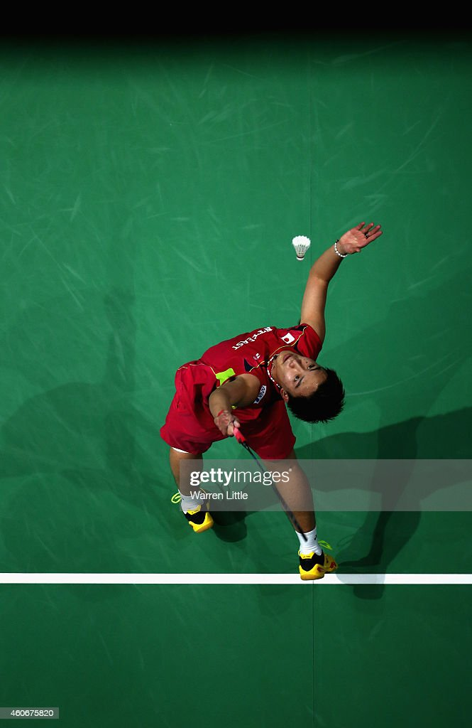 <a gi-track='captionPersonalityLinkClicked' href=/galleries/search?phrase=Kento+Momota&family=editorial&specificpeople=9148050 ng-click='$event.stopPropagation()'>Kento Momota</a> of Japan in action against Tommy Sugiarto of Indonesia during the Men's Singles Group B match on day three of the BWF Destination Dubai World Superseries Finals at the Hamdan Sports Complex on December 19, 2014 in Dubai, United Arab Emirates.