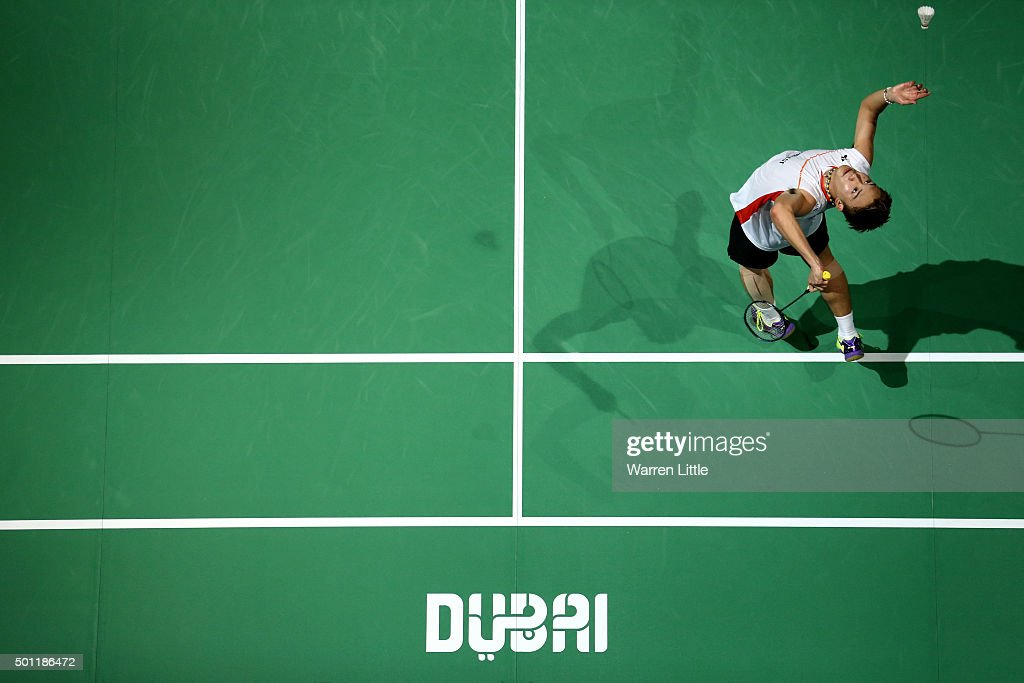 <a gi-track='captionPersonalityLinkClicked' href=/galleries/search?phrase=Kento+Momota&family=editorial&specificpeople=9148050 ng-click='$event.stopPropagation()'>Kento Momota</a> of Japan in action against Viktor Axelsen of Denmark during the final of the Men's Singles match on day five of the BWF Dubai World Superseries 2015 Finals at the Hamdan Sports Complex on December 13, 2015 in Dubai, United Arab Emirates.
