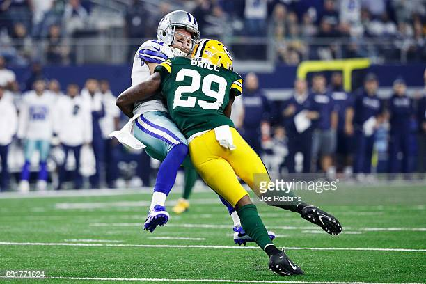Kentrell Brice of the Green Bay Packers tackles Cole Beasley of the Dallas Cowboys in the first half during the NFC Divisional Playoff Game at ATT...
