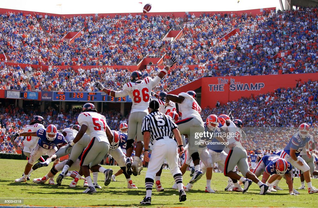 Kentrell Lockett of the Ole Miss Rebels blocks an extra point of Jonathan Phillips of the Florida Gators during the game at Ben Hill Griffin Stadium...
