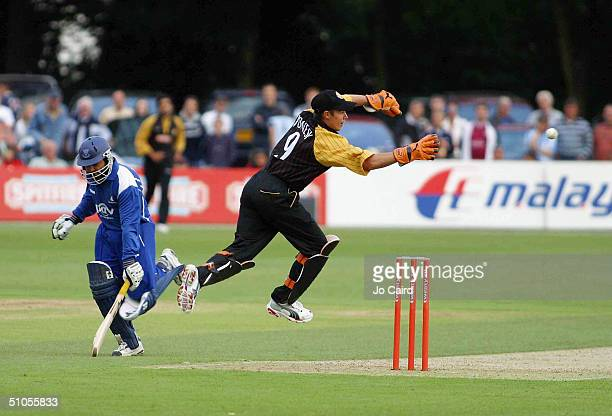 Kent's Geraint Jones tries to run out Sussex's Mushtaq Ahmed during the Twenty20 Cup match between Kent Spitfires and Sussex Sharks at The Canterbury...
