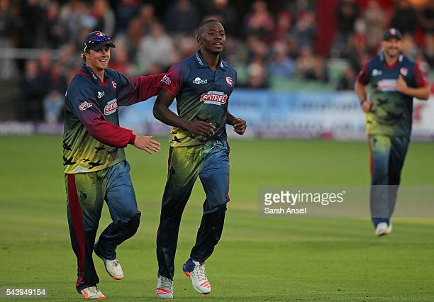 Kent's Kagiso Rabada is congratulated by his captain Sam Northeast after taking his second wicket in two overs during the NatWest T20 Blast match...