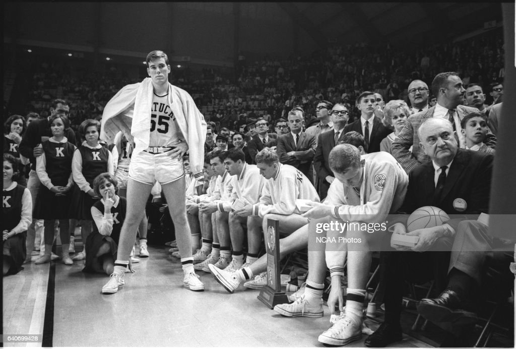 Kentucky coach Adolph Rupp (with basketball) and his players in the 1966 championship game watch as Texas Western (UTEP) receives the championship trophy. Kentucky lost 65-72 after Texas Western's Bobby Joe Hill had successive steals to turn the game around. .Photo: © Rich Clarkson / NCAA Photos via Getty Images