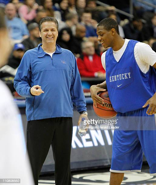 Kentucky coach John Calipari left laughed with guard Brandon Knight as Kentucky practiced at the Prudential Center for their Sweet 16 matchup with...