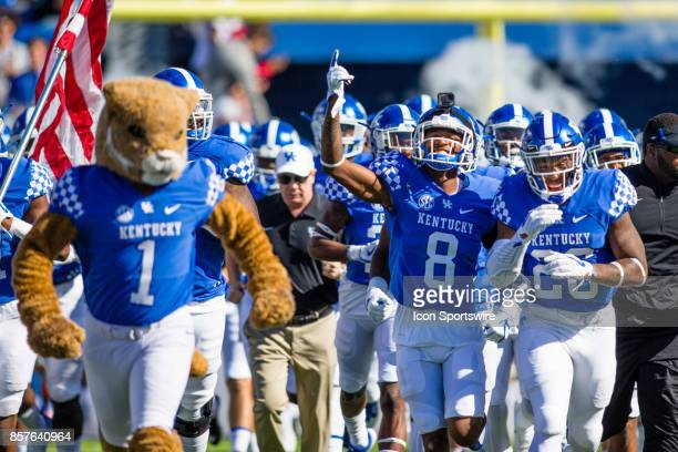 Kentucky cornerback Derrick Baity Jr and running back Benjamin Snell Jr lead Kentucky onto the field before a regular season college football game...