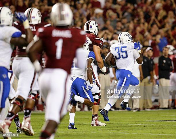 Kentucky defensive end Denzil Ware picks up a South Carolina twopoint conversion attempt returns it in the fourth quarter at WilliamsBrice Stadium in...