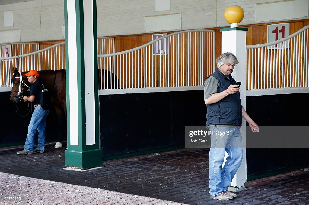 Kentucky Derby trainer Steve Asmussen schools horses in the paddock following a training session at Churchill Downs on May 03, 2016 in Louisville, Kentucky.