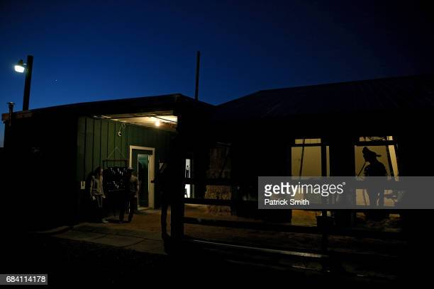 Kentucky Derby winner Always Dreaming stands in the barn prior to a training session for the upcoming Preakness Stakes at Pimlico Race Course on May...