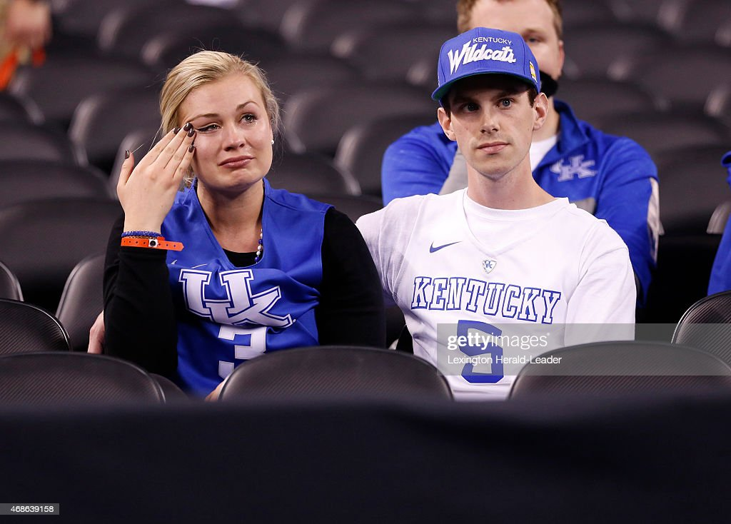 Kentucky fans bemoans the Wildcats' 71-74 loss against Wisconsin in the NCAA Tournament national semifinal at Lucas Oil Stadium in Indianapolis on Saturday, April 4, 2015.