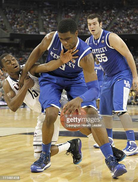 Kentucky forward Terrence Jones and Connecticut guard Kemba Walker battle for the ball during secondhalf action in the second game of the men's NCAA...