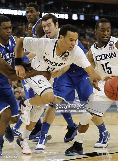 Kentucky forward Terrence Jones fouls Connecticut guard Shabazz Napier late in the second game of the men's NCAA Final Four semifinals at Reliant...