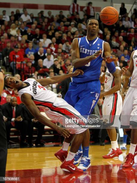 Kentucky forward Terrence Jones gets called for a charge as he runs into Georgia guard Dustin Ware during game action at Stegeman Coliseum in Athens...