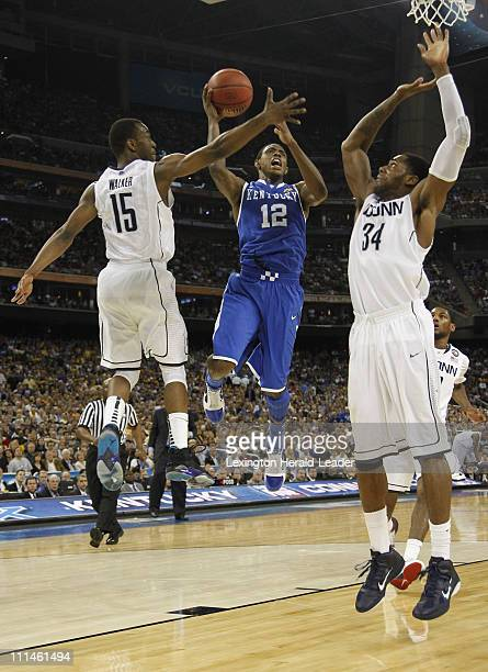 Kentucky guard Brandon Knight looks for a shot against Connecticut guard Kemba Walker and Connecticut center Alex Oriakhi during the second half of...