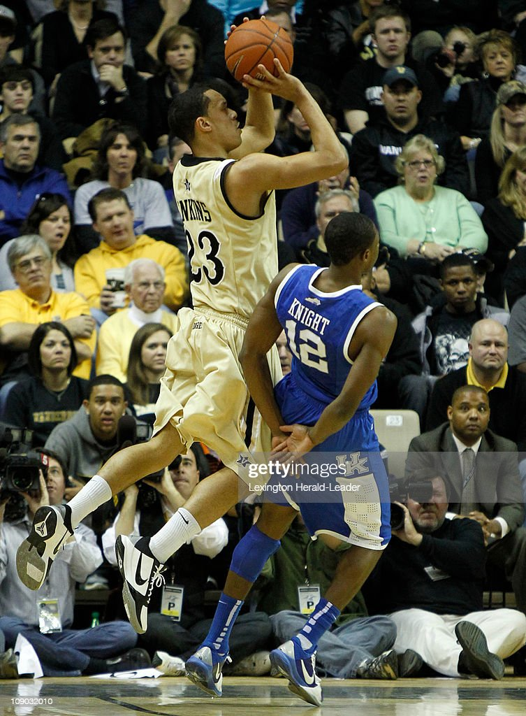 Kentucky guard Brandon Knight pulls his arms down to avoid fouling Vanderbilt guard John Jenkins on a shot attempt during the game at Memorial Gym in...