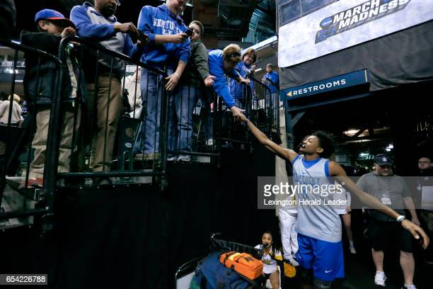 Kentucky guard De'Aaron Fox shakes hads with fans as the team walks around the stands after practice for their firstround NCAA Tournament game...