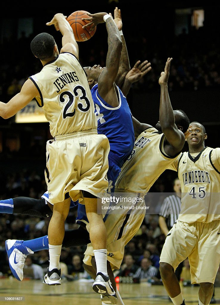 Kentucky guard DeAndre Liggins has his shot blocked by Vanderbilt guard John Jenkins as he drove the lane during game action at Memorial Gym in...