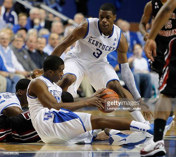 Kentucky guard Doron Lamb scoops up a loose ball and gets it to teammate Terrence Jones during geme action against South Carolina at Rupp Arena in...