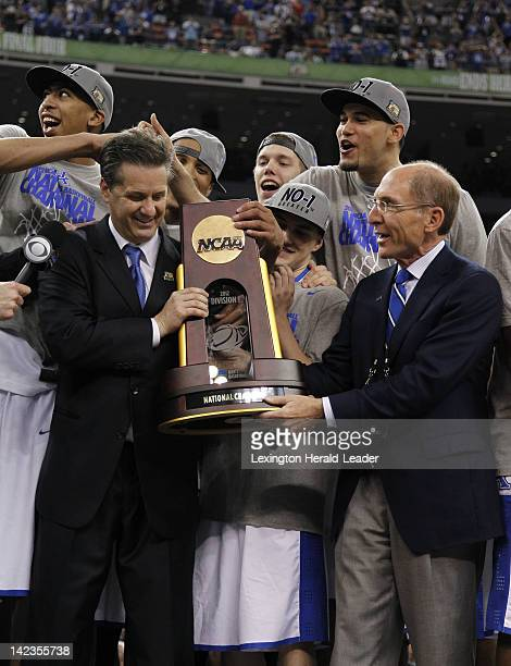 Kentucky head coach John Calipari and university president Eli Capilouto with the championship trophy after a 6759 win over Kansas in the NCAA...