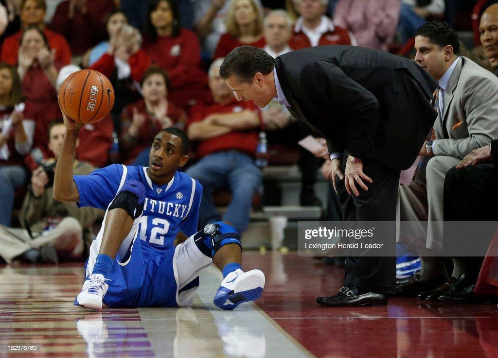 Kentucky head coach John Calipari talks to his point guard, Ryan Harrow (12), after he turned over the ball against Arkansas at Bud Walton Arena in Fayetteville, Arkansas, on Saturday, March 2, 2013. Arkansas prevailed, 73-60.