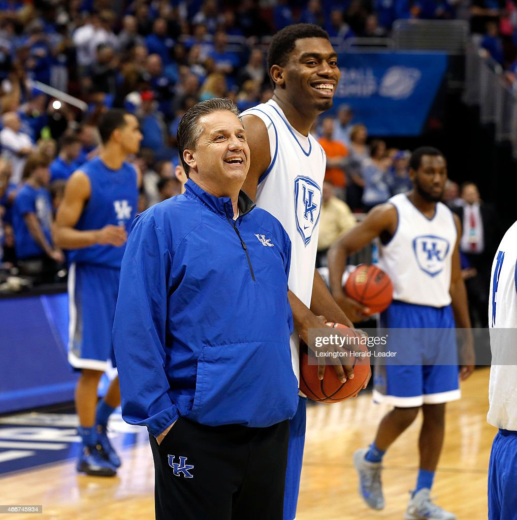 Kentucky head coach <a gi-track='captionPersonalityLinkClicked' href=/galleries/search?phrase=John+Calipari&family=editorial&specificpeople=619983 ng-click='$event.stopPropagation()'>John Calipari</a>, with center <a gi-track='captionPersonalityLinkClicked' href=/galleries/search?phrase=Dakari+Johnson&family=editorial&specificpeople=10784938 ng-click='$event.stopPropagation()'>Dakari Johnson</a> behind him, laughs near the end of practice in the KFC Yum Center in Louisville, Ky., on Wednesday, March 18, 2015. Kentucky opens NCAA Tournament play against Hampton on Thursday.