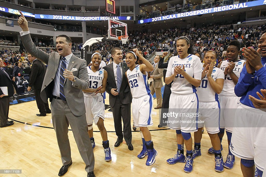 Kentucky head coach Matthew Mitchell and the team sings the school fight song after a 69-62 win against Delaware in their NCAA Tournament East Region Sweet 16 game on Saturday, March 30, 2013, at the Webster Bank Arena at Harbor Yard in Bridgeport, Connecticut.