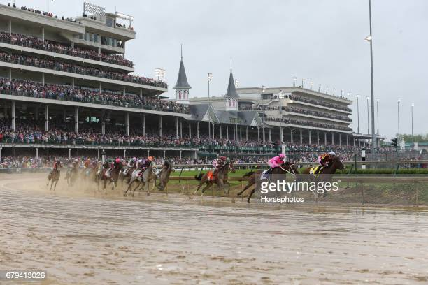 Kentucky Oaks field in first turn Abel Tasman with Mike Smith up wins the Longines Kentucky Oaks at Churchill Downs on May 5 2017 in Louisville...