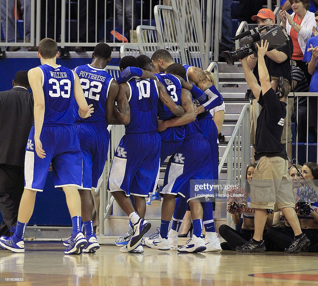 Kentucky players carry off teammate forward Nerlens Noel (3), after he suffered an injured leg in the game agianst Florida at the O'Connell Center in Gainesville, Florida, Tuesday, February 12, 2013. Florida defeated UK