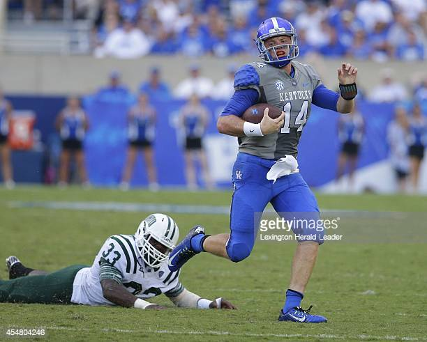 Kentucky quarterback Patrick Towles gets around the end on Ohio linebacker Blair Brown at Commonwealth Stadium in Lexington Ky on Saturday Sept 6...