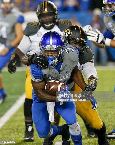 Kentucky running back Jojo Kemp is tackled from behind by Missouri defensive end Charles Harris on Saturday Sept 26 at Commonwealth Stadium in...