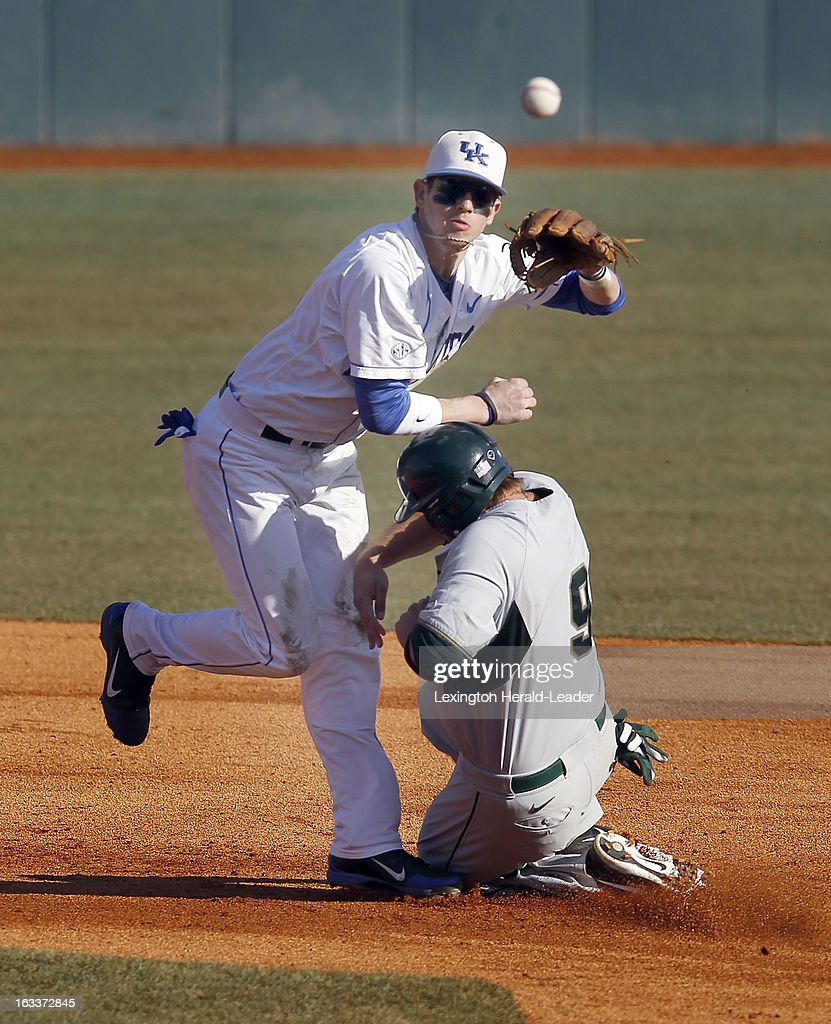 Kentucky second baseman J.T. Riddle forces Michigan State's Jimmy Pickens (9) at second base on the front end of an inning-ending double play in the second inning at Cliff Hagan Stadium in Lexington, Kentucky, on Friday, March 8, 2013.