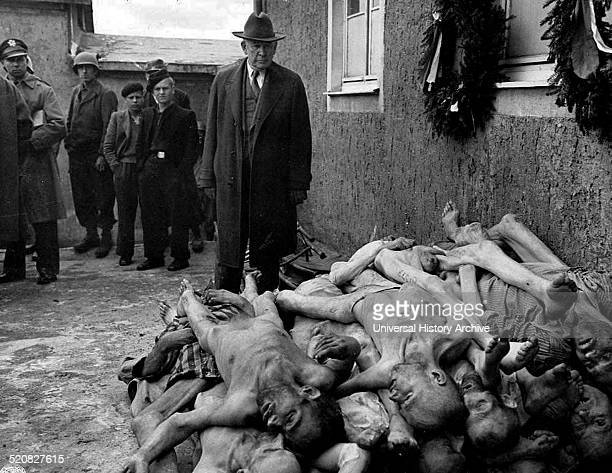 Kentucky Senator Alben W Barkley visting a German concentration camp The photo shows the Senator stood infront of a pile of dead bodies at Buchenwald...