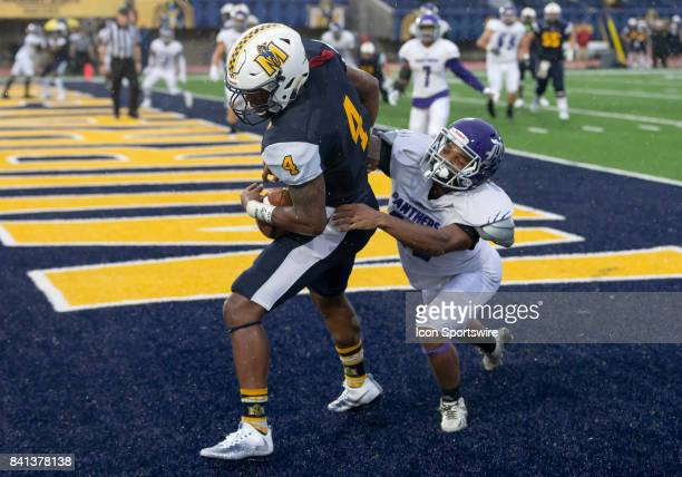 Kentucky Wesleyan defensive back Chris Dinwiddie hangs off of Murray State wide receiver Jordon Gandy as he catches a pass in the endzone during the...