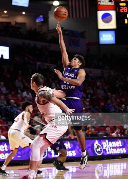 Kentucky Wesleyan Panthers forward Amir Warnock takes a running shot over Western Kentucky Hilltoppers forward Justin Johnson during the first half...